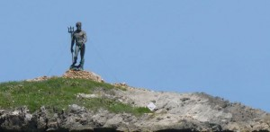 Neptune stands 22 feet tall atop his craggy islet off Puerto Plata's malecón. Photo by Matt Bokor